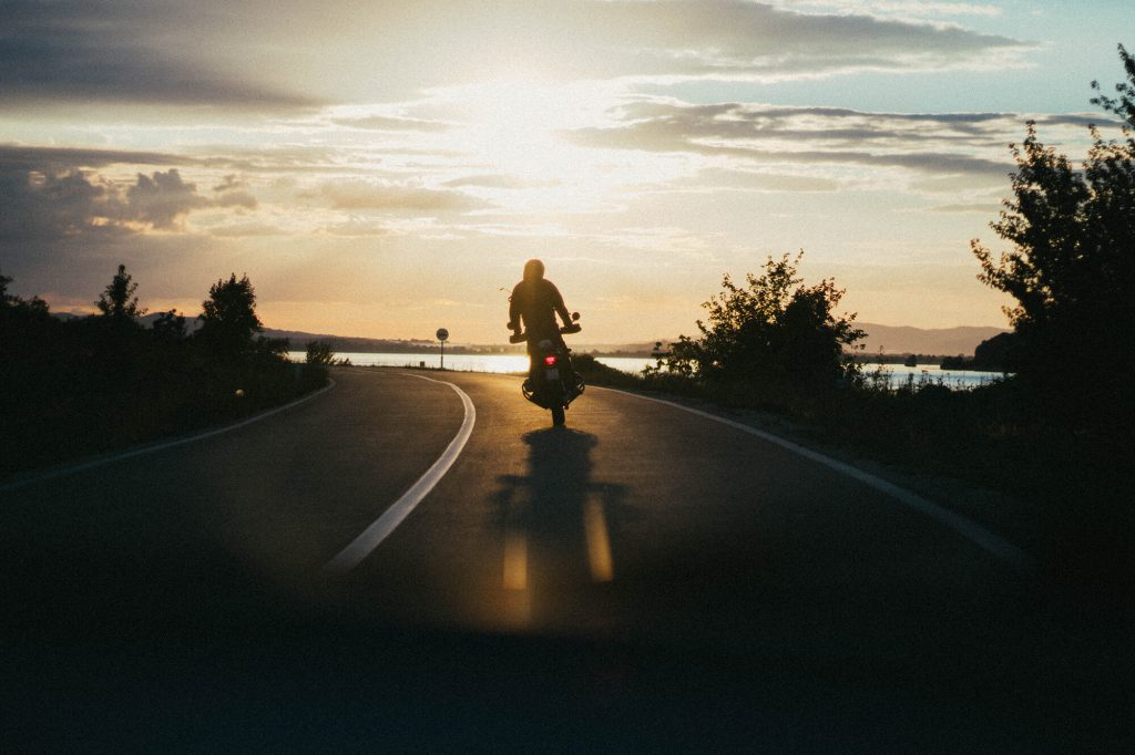 A motorcyclist should hire a motorcycle accident attorney in case of an accident, even on an open road like this.