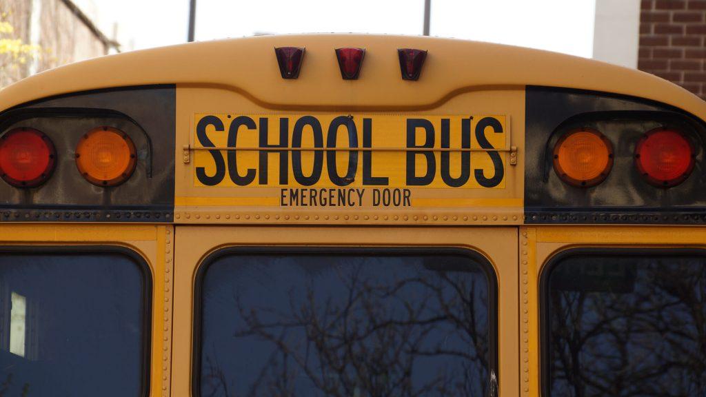 School bus in school zone driving safely in Rio Rancho.