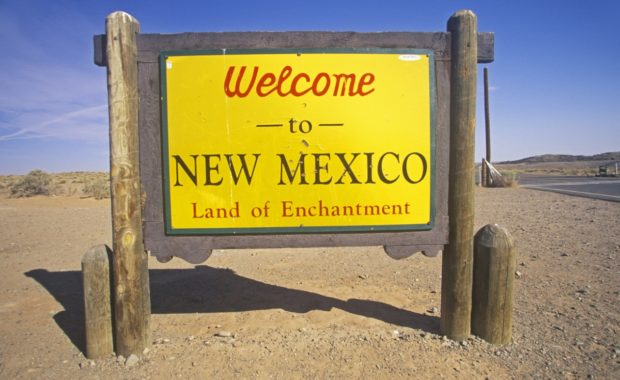 """A yellow sign that says """"Welcome to New Mexico"""""""